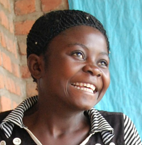 "She is a survivor of sex slavery. Kidnapped by an armed group at the age of 13, she spent the following three years under its control. Her life depended on the will of her commander, who forced her to transport dry minerals during he day and raped her nightly as his ""wife."" Forced marriage and its connection to enslavement remain poorly understood.  Source: freetheslaves.net"