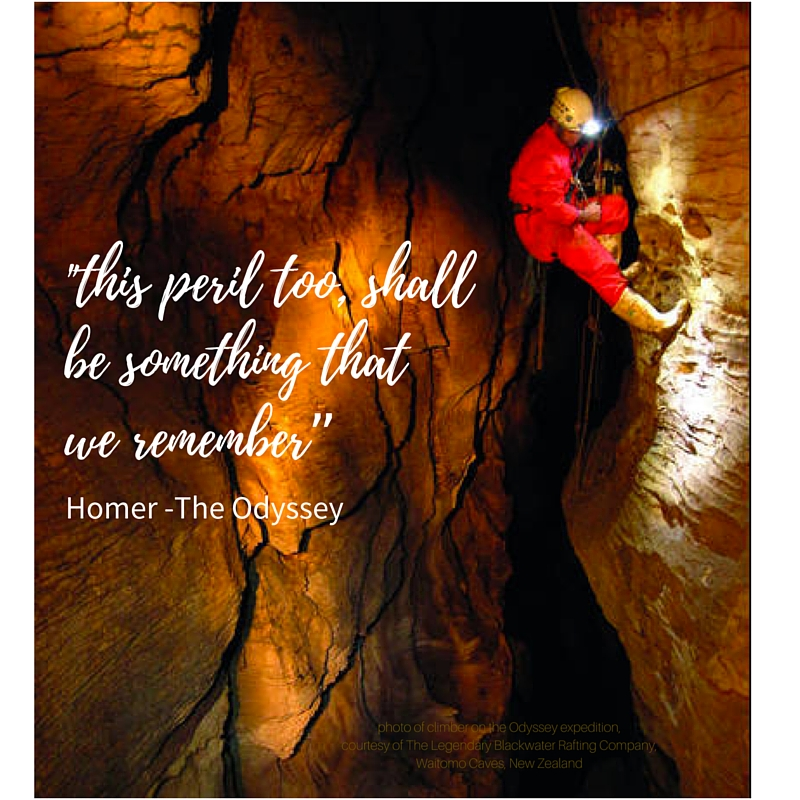 Photo of a climber high up on a rockface in the Odyssey Adventure, Waitomo Caves, New Zealand